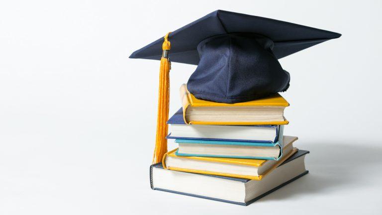 graduation cap on book